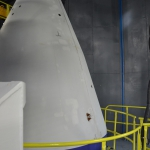Top of stationary column (left) holding the launch container in place. In the background: closed doors of the service tower (credits: Eurockot)