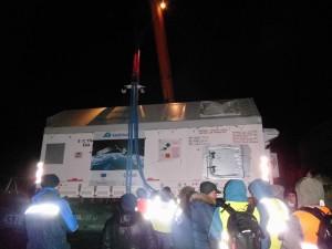 Satellite container loading onto rail car