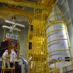 Payload fairing half-shell (right) prepared to be put in place after completion of stacking