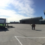 Panoramic view of the unloading process at Talagi airport (credits: Eurockot Launch Services)